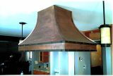 Antiqued copper kitchen hood for Skywalker Construction